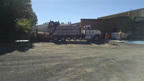Pouring Asphalt in elementary parking lot